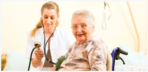 caregiver checing blood pressure of patient
